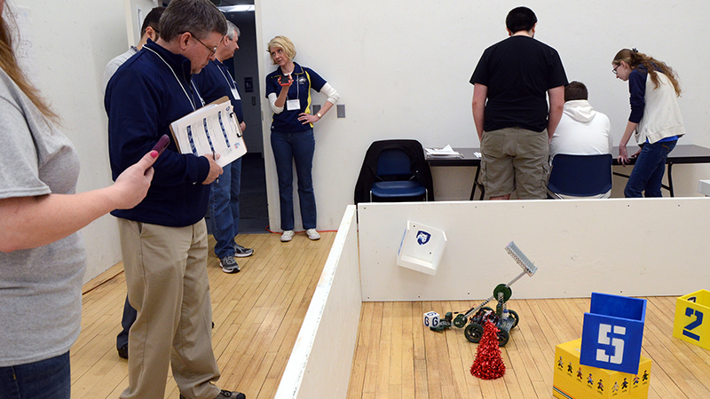 Judges observe students competing in the land portion of the SeAL challenge on Friday, April 12 at Penn State Altoona.