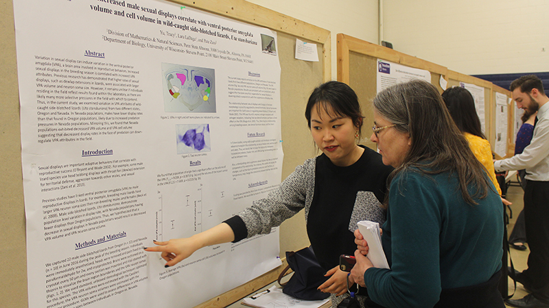 Student presenter Tracy Yu chats with Dr. Mary Kananen about her poster presentation
