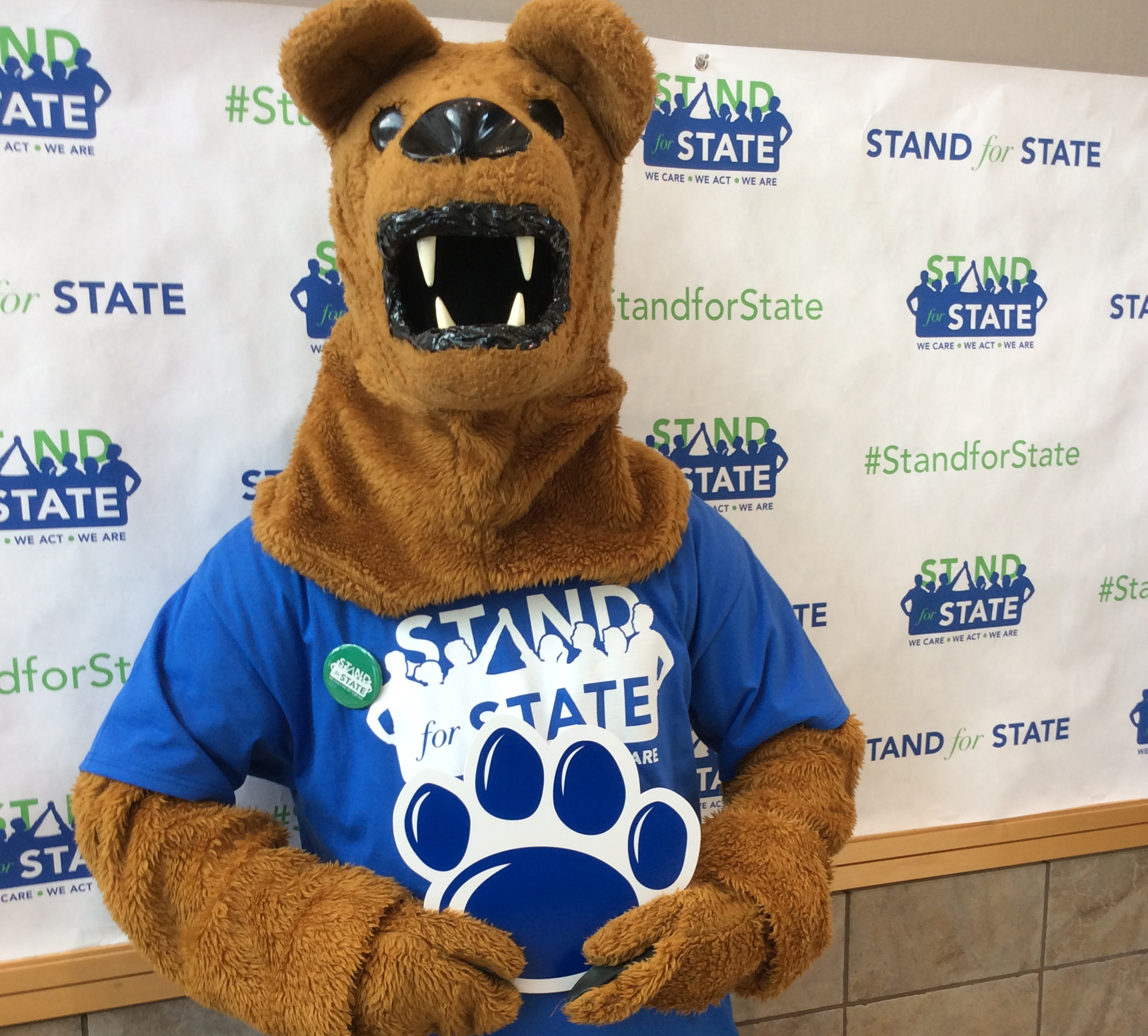The Nittany Lion mascot wearing a Stand for State T-shirt