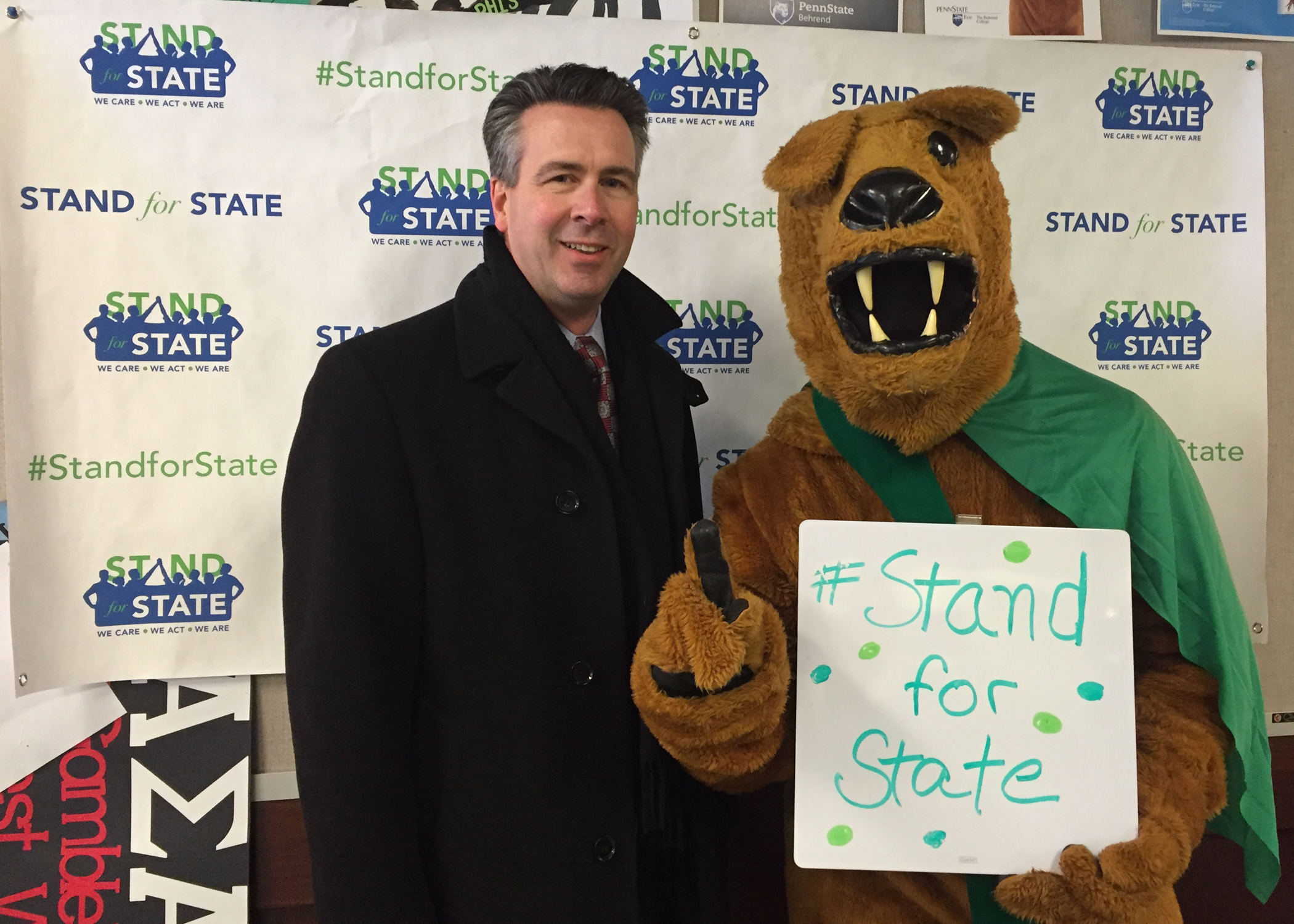 Penn State Behrend Chancellor Ralph Ford and the lion mascot
