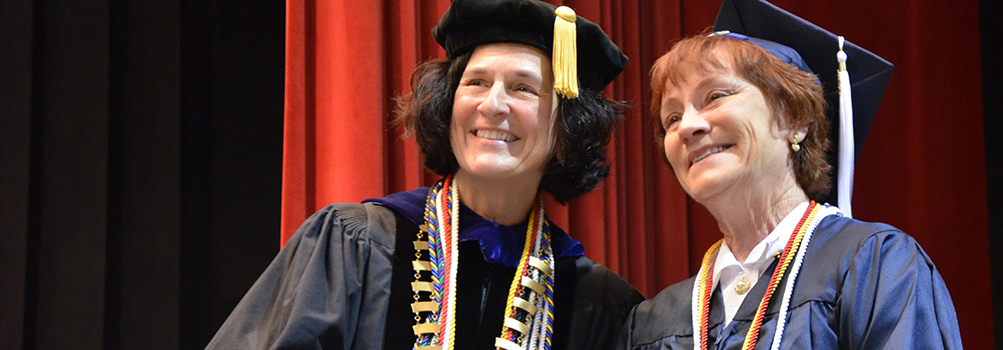 Chancellor and Dean Lori J. Bechtel-Wherry with a graduate at spring 2017 commencement