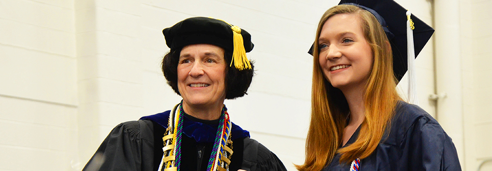 Chancellor and Dean Lori J. Bechtel-Wherry with a graduate at fall 2018 commencement