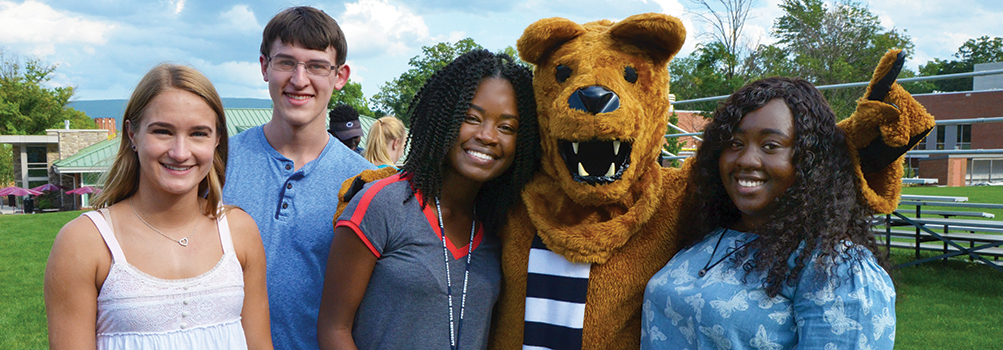First year students pose with the Nittany Lion during orientation