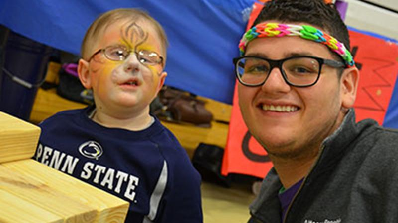 Ellman spends time playing with Penn State Altoona's THON child, Collin Kratzer, during the college's 12-hour Dance Marathon event