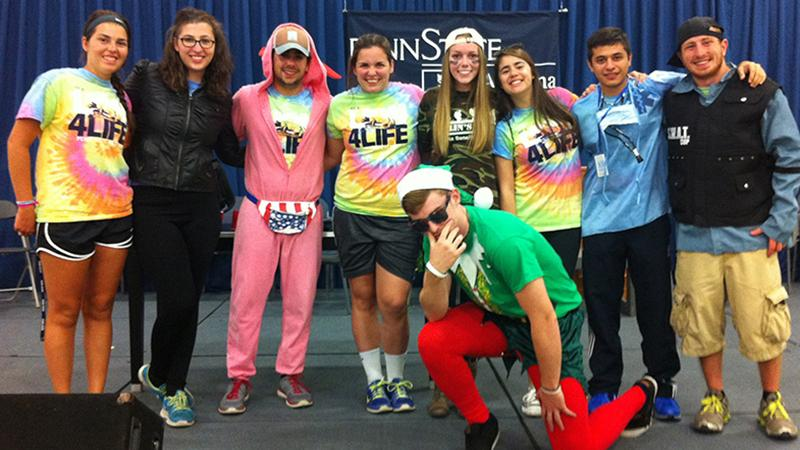 Delsite (second from left) poses with some of her Orientation Leader friends at the Freshman Follies.
