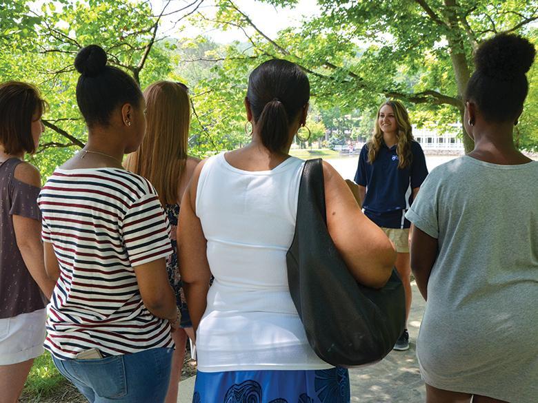 A lion ambassador giving a campus tour