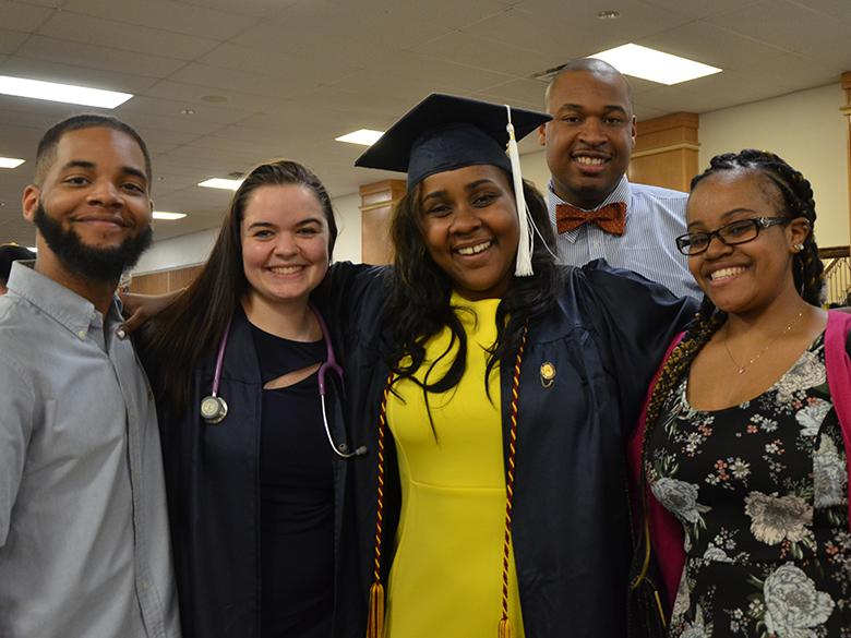 A family poses for a photo at spring 2018 commencement