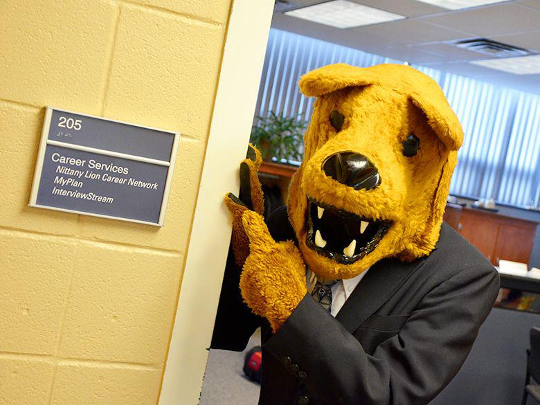 Nittany Lion pointing at the Career Services office sign