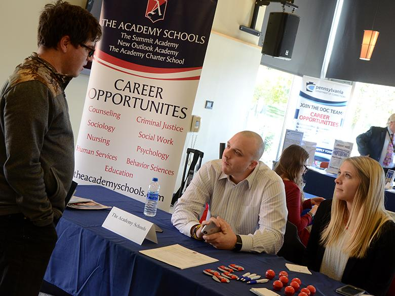 Employers and students meeting during a career fair