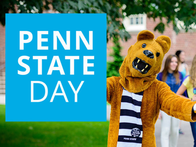 Nittany Lion holding a Penn State Day sign