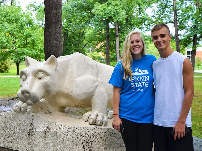 Posing with the Nittany Lion statue