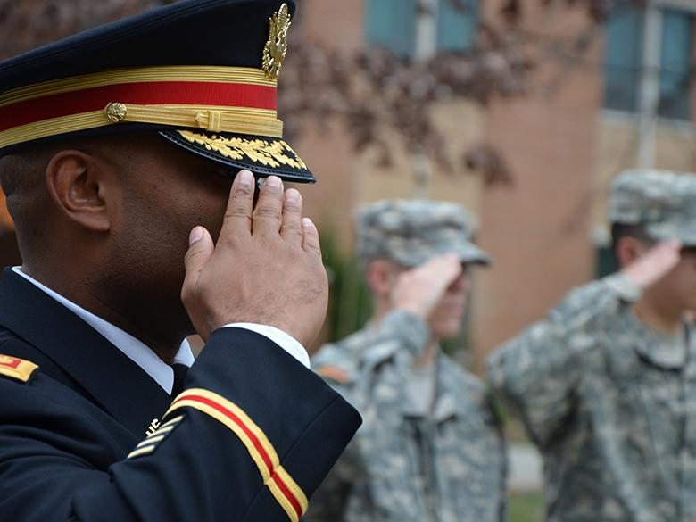Veterans salute at Veterans Day Event
