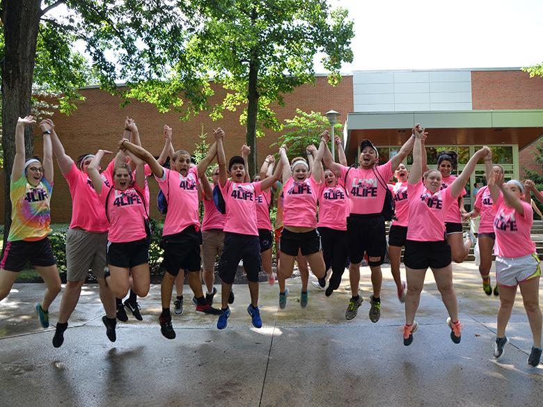 Orientation Leaders jump for a photo on move in day