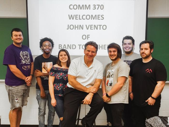 Penn State Greater Allegheny communications students pose with John Vento, founder of Pittsburgh's Band Together.