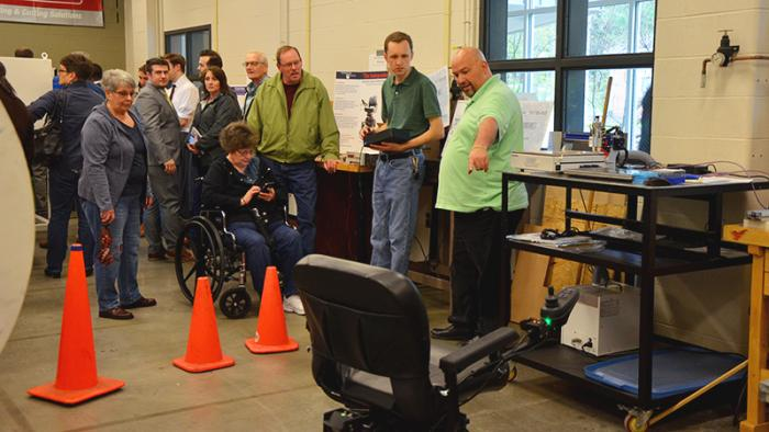 Faculty and students demonstrate the Independence project wheelchair
