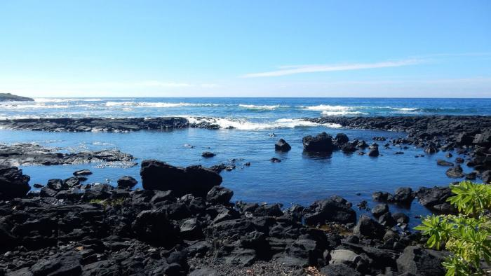 A black lava beach at Whittington Beach Park on the southern coast of the Big Island