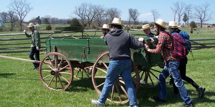 History students pushing a wagon