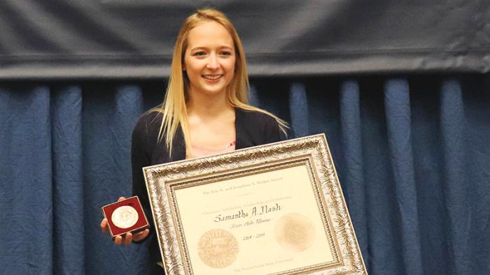 Samantha Nash poses with the Walker Award during the Student Awards Ceremony, held April 28, 2019.