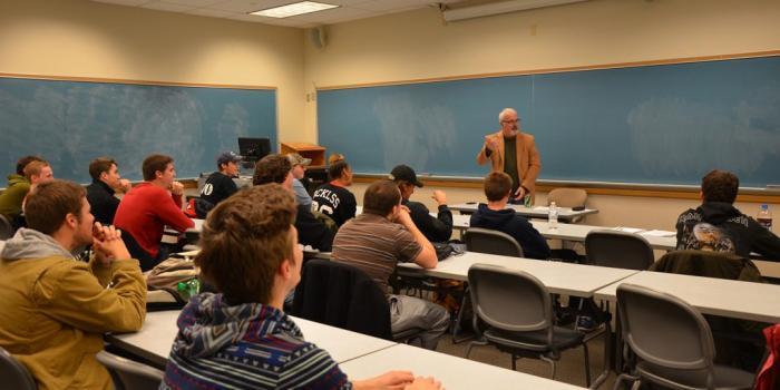 Professor White teaching a course
