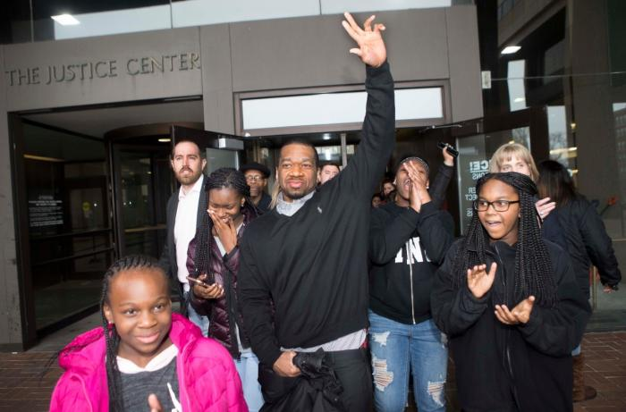 Ru-El Sailor walks out of the Cuyahoga County Courthouse with his family in March after spending 15 years in prison for a murder he did not commit.
