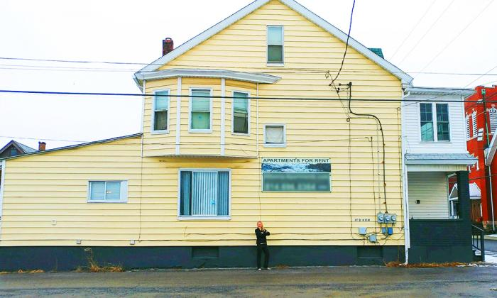 Taylor Stoudnour in front of one of her rental properties
