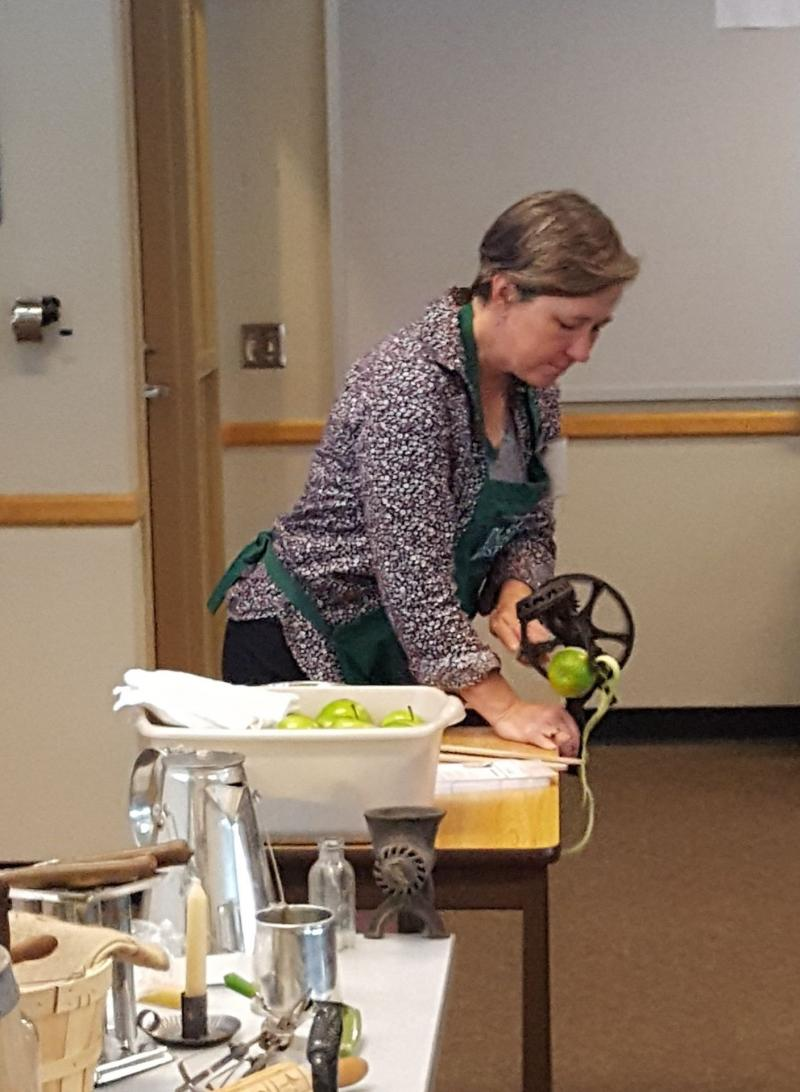 Rita Graef, curator of the Pasto Agricultural Museum, demonstrates a late 19th-century apple peeler