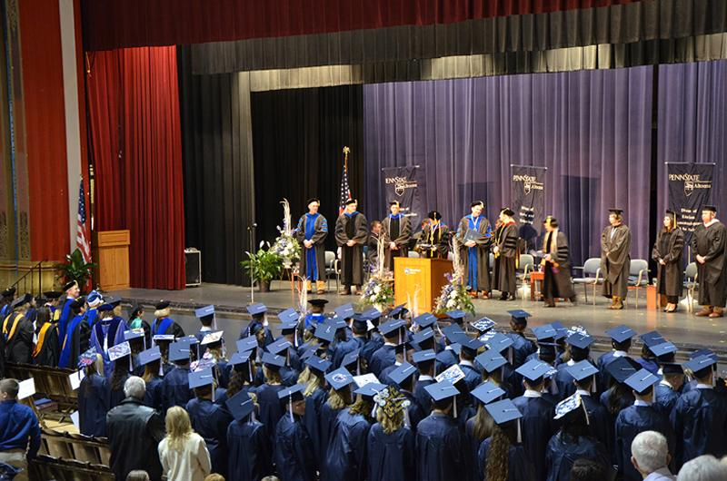 The graduates and the stage party at Fall 2016 Commencement