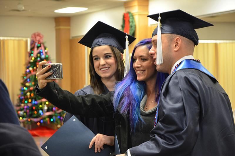 Posing for a photo after the Fall 2019 Commencement ceremony