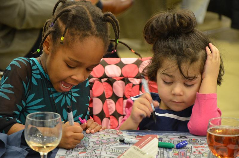 Two children enjoy the 2017 MLK Reflection Luncheon