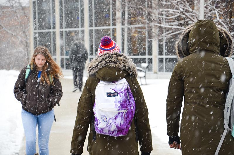 Students walk past Eiche library