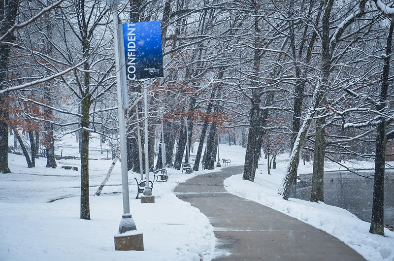 A snowy path on campus