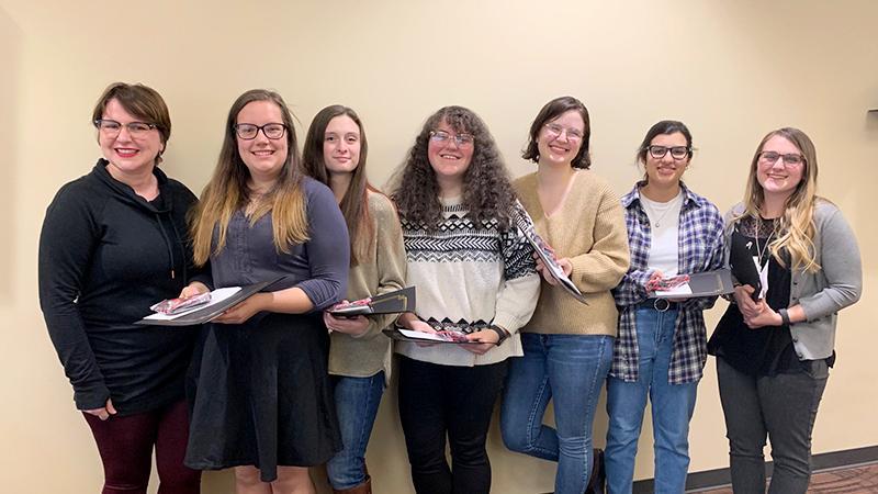 Senior English students pose for a photo