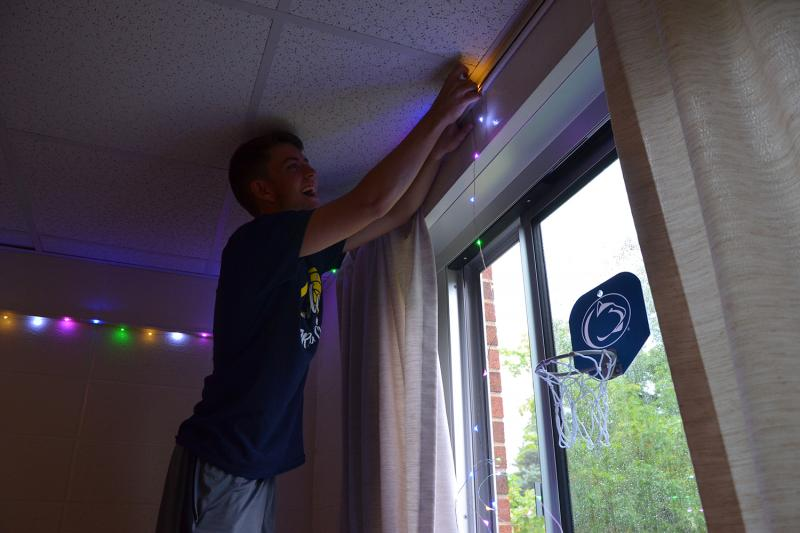 A student decorates their residence hall room
