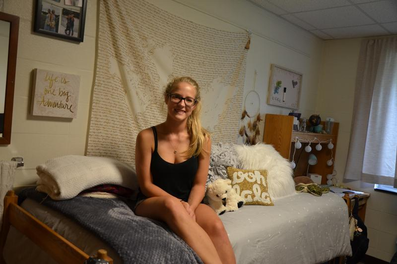 First-year student relaxes in her newly-decorated residence hall room