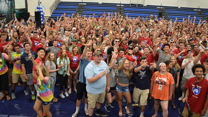 The class of 2021 and their orientation leaders pose for a group photo