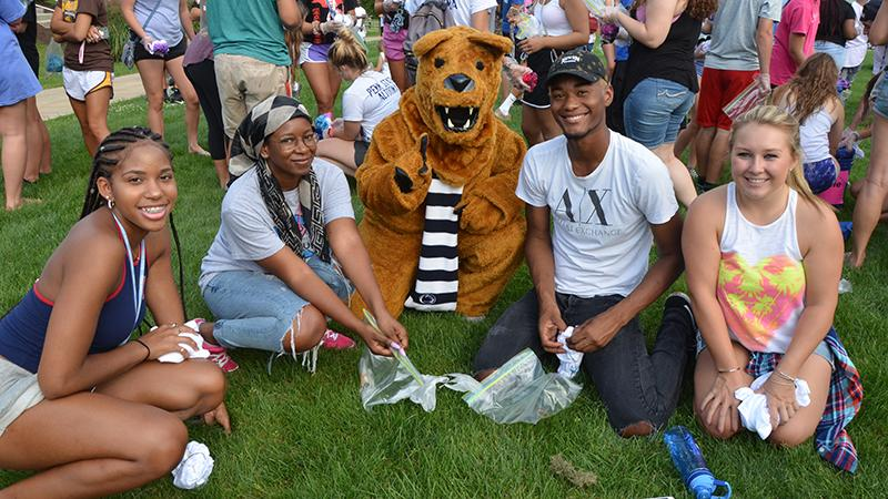 First year students pose with the Nittany Lion at the Friends for Life event.