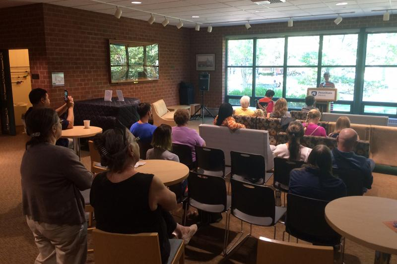 The audience listens as a faculty member reads from Erin Kelly's new Chapbook