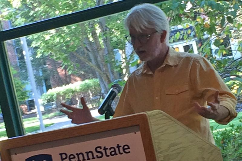 A faculty member reads from the work of Erin Kelly