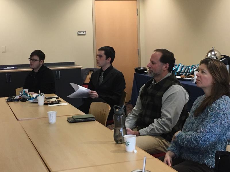 Faculty and students observe English senior seminar presentations