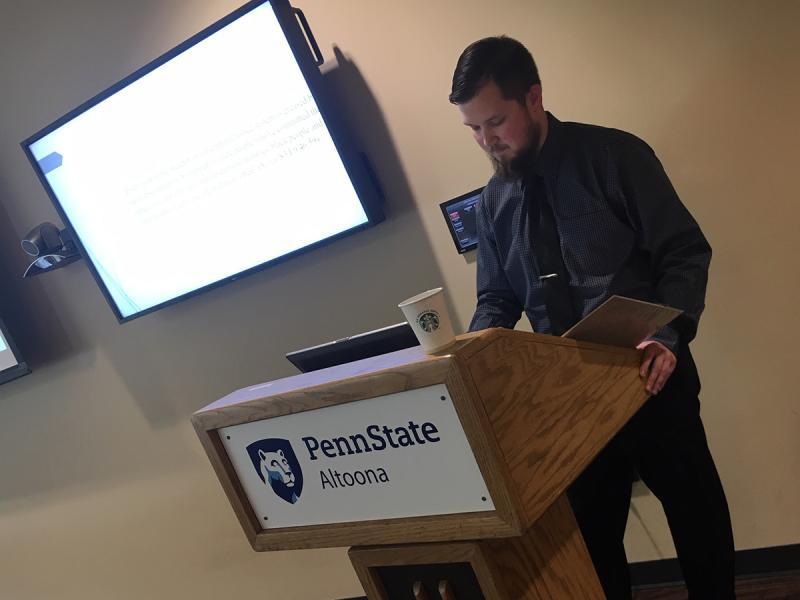 A senior English student offers a seminar presentation