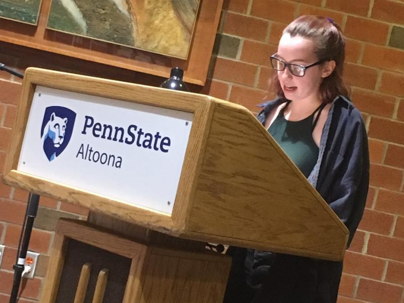 A student reading at the spring 2019 Hard Freight Cafe