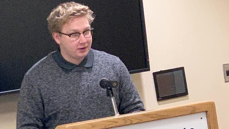 A student offers a senior English presentation