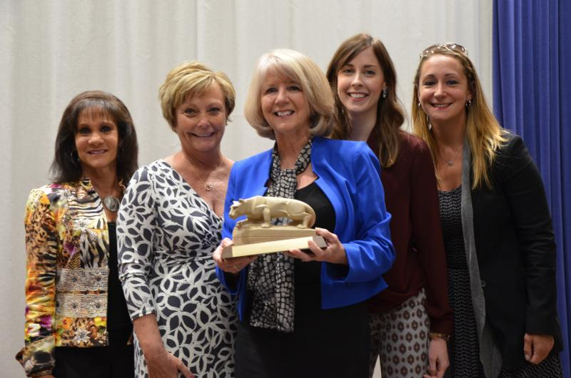 Denise Mason (center) and the staff of the office of development and alumni relations