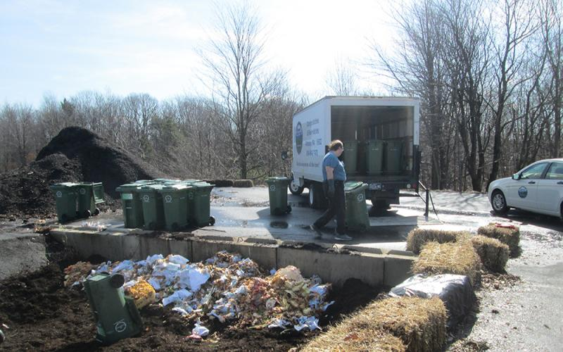 Student James Edwards helps unload food waste at the Ashville compost facility.