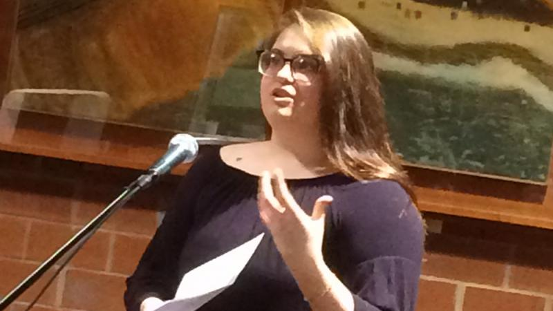A student reading at the spring 2018 Hard Freight Cafe
