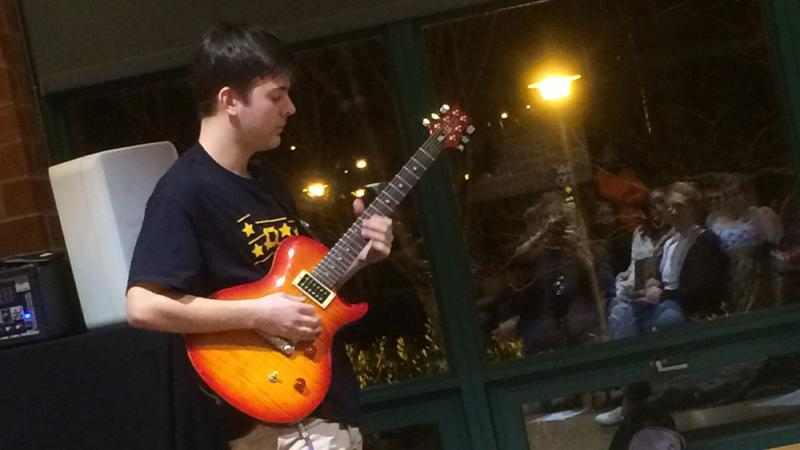 A student performing at the spring 2018 Hard Freight Cafe