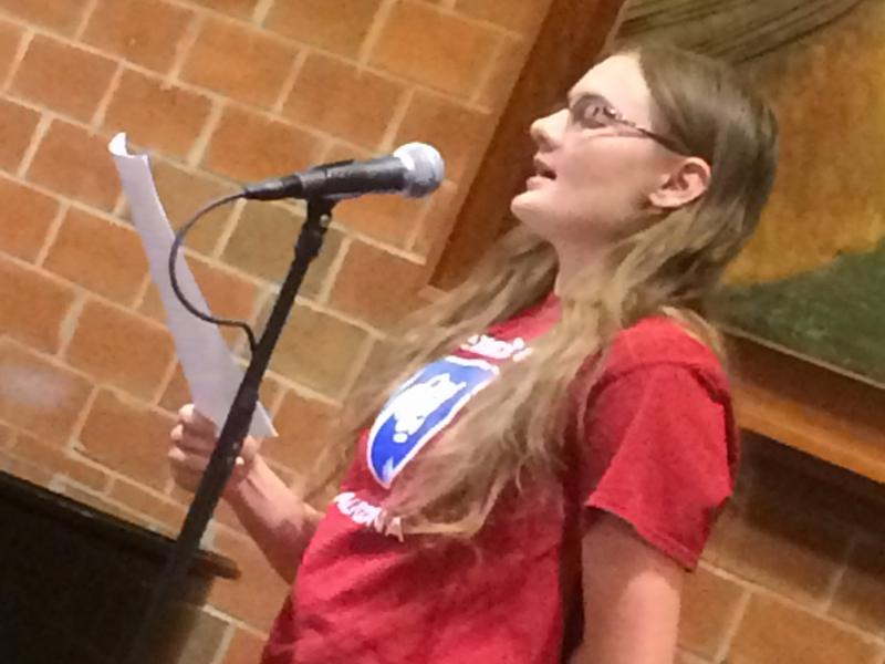 A student offers a reading as part of the Hard Freight Cafe.