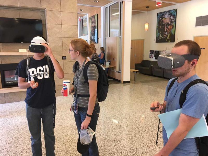 Students looking at 360 virtual reality videos