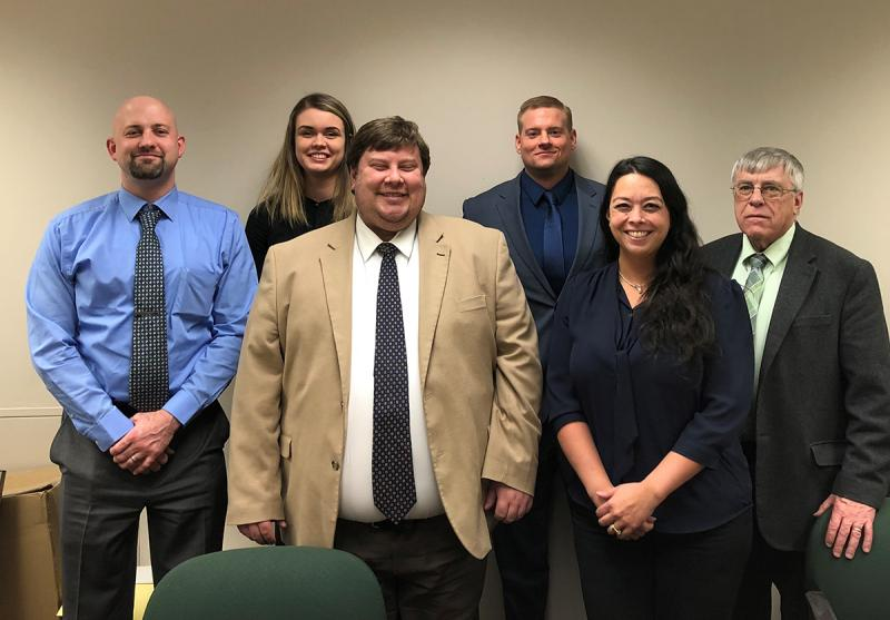 John Hicks (fourth from left) is pictured with some of the people he worked with during his internship at the Blair County Courthouse.