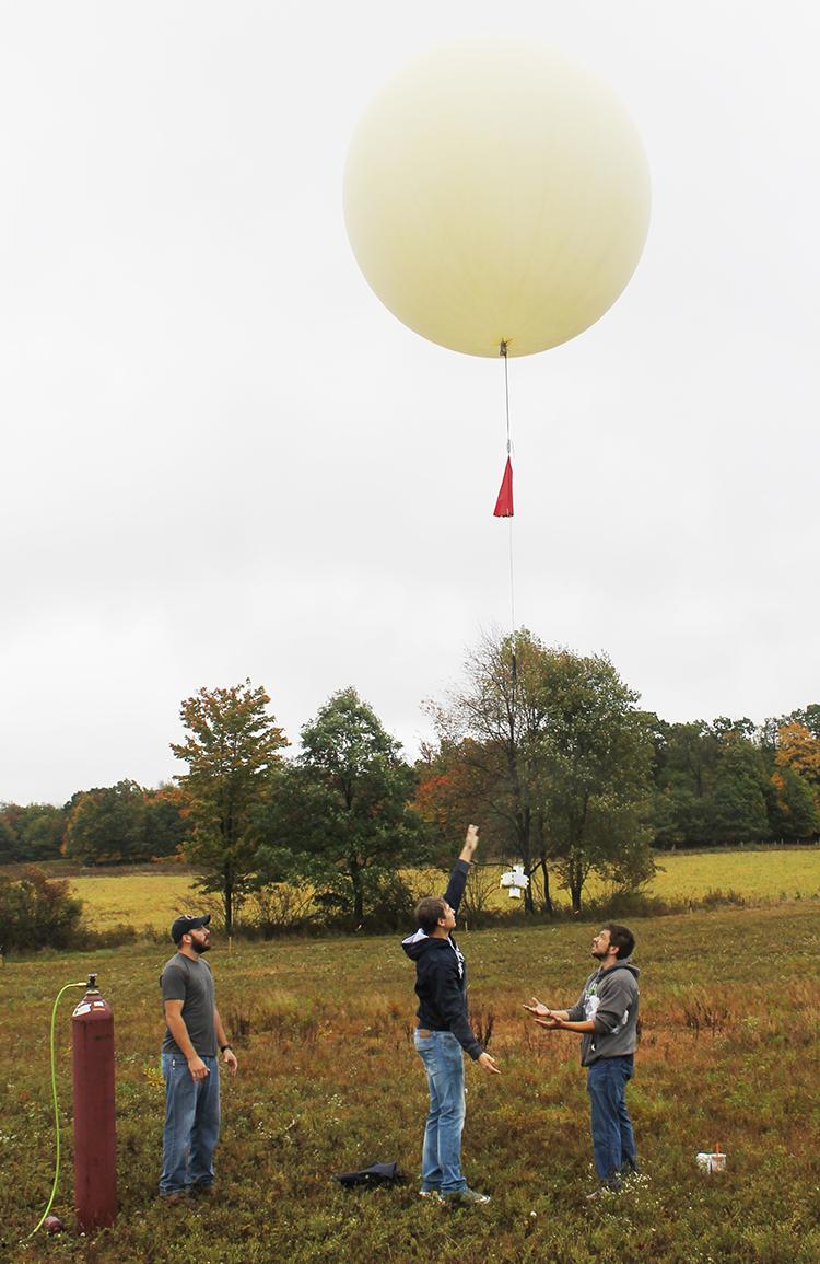 EMET students watch as their balloon launches